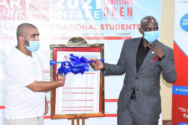 Rajiv and Victoria University acting VC Mr. Muganga at the launch of the Bursary Scheme (PHOTO/Courtesy).