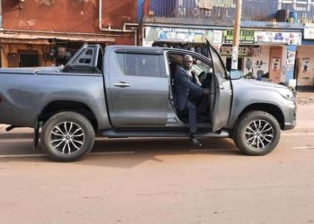 Basajja Mivule getting out of his new ride (PHOTO/Courtesy).