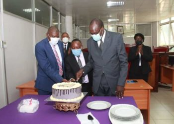 Officials cutting a cake at the luncheon farewell to the outgoing Justice Micheal Elubu (PHOTO/Courtesy).