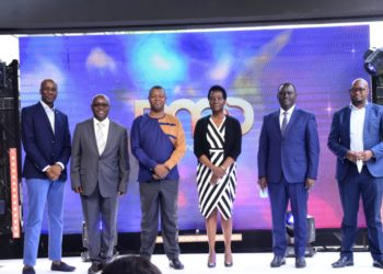 Mr. Hassan Saleh (3rd left), the Managing Director, MultiChoice Uganda, Mrs. Susan Atengo Wegoye (C), the Director Legal Affairs, Uganda Communications Commission (UCC), Mr. Meddie Kaggwa (2nd right), the Head Multimedia and Content at Uganda Communications Commission (UCC), Mr. Kin Kariisa (3rd right), Chairman, National Association of Broadcasters (NAB), Mr. Robert Kabushenga (2nd left), former Managing Director & CEO, New Vision, and Mr. Charles Hamya (L) , former Managing Director, MultiChoice Uganda at the launch of Pearl Magic Prime (PMP) a new homegrown entertainment channel dedicated to Ugandan content produced by Ugandans. This was at MultiChoice Uganda, Head Offices in Kololo on 8th February, 2021. PMP will be available on DStv channel 148 featuring shows like Sanyu, Prestige, Mama & Me and Story Yange (PHOTO/Courtesy).