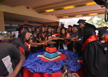 Graduands cut cake at their graduation held at Speke Resort Munyonyo (PHOTO/Courtesy).