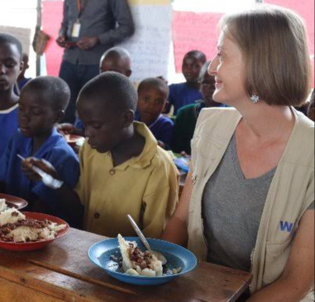 World Food Programme Rwanda Country Director Edith Heines with some of the refugees (PHOTO/Courtesy).