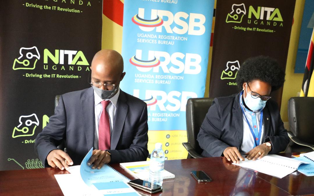 URSB Registrar General Ms. Mercy Kainobwisho (R) & NITA-U Executive Director Dr. Hatwib Mugasa signing the MoU at the URSB Headquarters in Kampala (PHOTO/Courtesy).