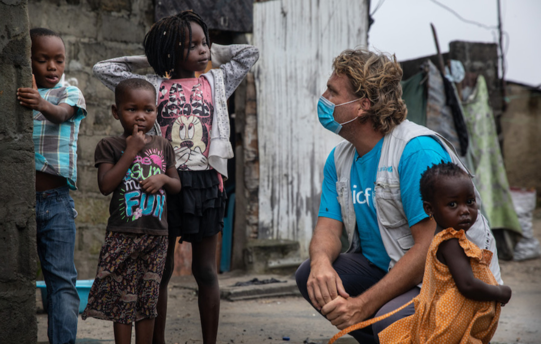 Daniel Timme, a UNICEF spokesman in Mozambique with children (PHOTO/Courtesy).