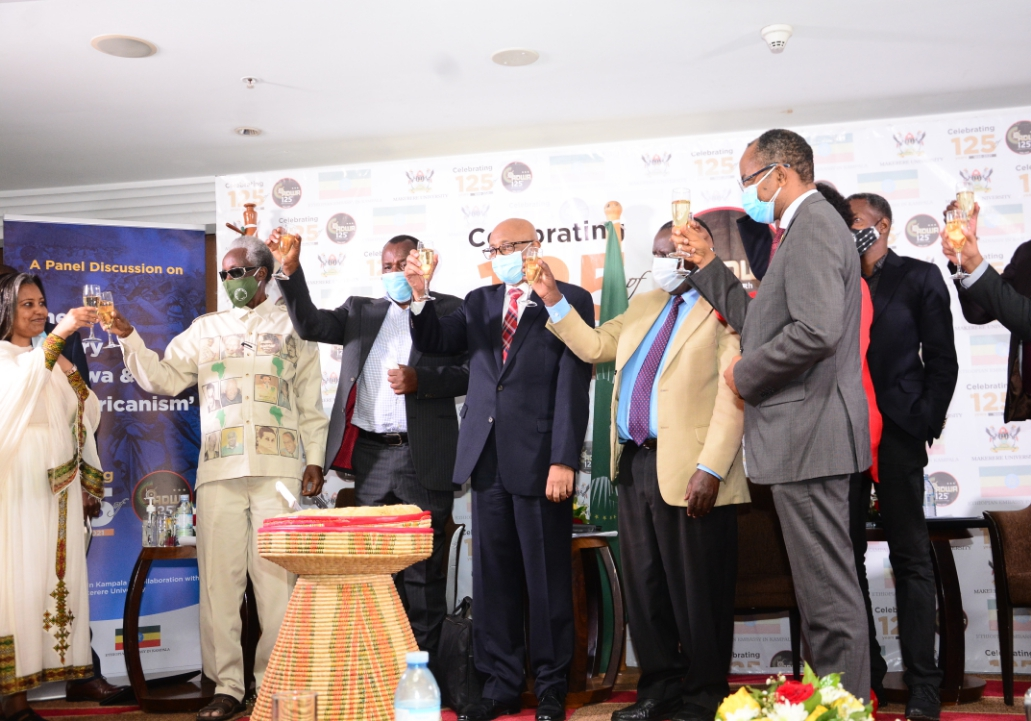 The Ethiopian Ambassador to Uganda H.E Almetsehay Meseret is joined by Security Minister Gen Elly Tumwiine in a toast for Adwa Victory at the event (PHOTO/Courtesy).