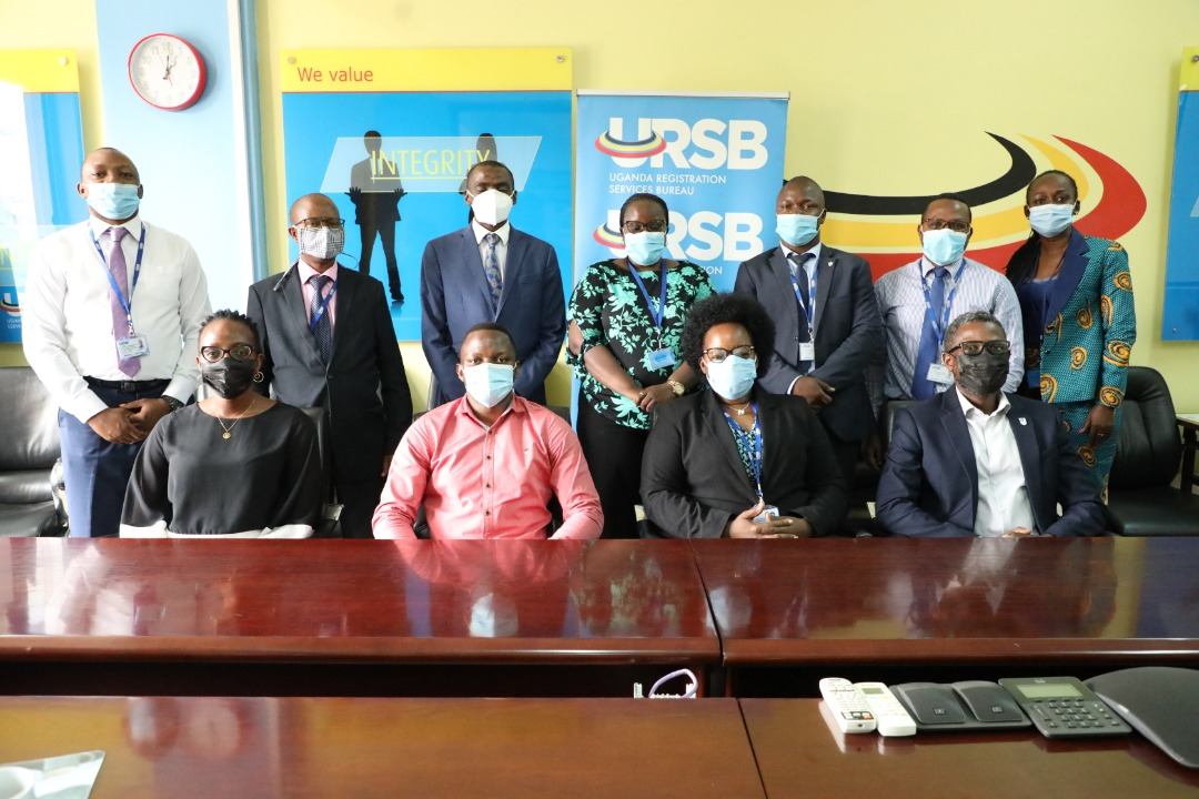 The Registrar General Mercy K.Kainobwisho (Seated 2nd R) & Tony Otoa the CEO Stanbic Business Incubator in a group photo after a meeting at the URSB Headquarters in Kampala (PHOTO/Courtesy).