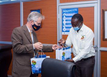 Chairman Migereko giving the Ambassador some UTB goodies (PHOTO/Courtesy).