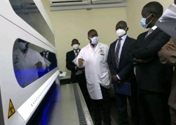 Dr Jackson Orem with the visiting MPs on the Health Committee in the pharmacy at the Uganda Cancer Institute (PHOTO/Courtesy).