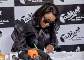 Singer Lydia Jazmine signing a contract with Radiant (PHOTO/Courtesy).
