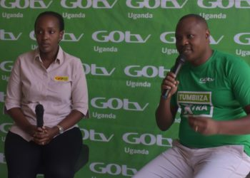 L-R: Ms. Joan Semanda Kiiza, the PR and Communications Manager and Mr. Jonah Wegoye, the Head of Sales MultiChoice Uganda during the launch of a new GOtv offer (PHOTO/Courtesy)