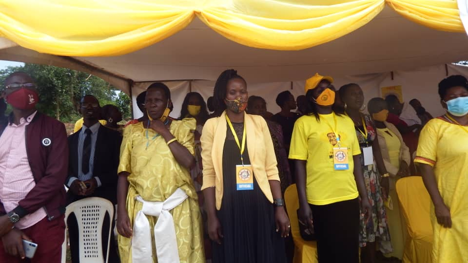 Party members during a meeting at Sisa perish play ground on Sunday (Sarah Namukisa).