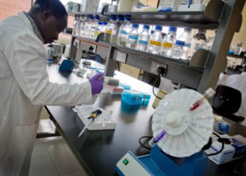 An attendant in Makerere University Laboratory (PHOTO/Courtesy).