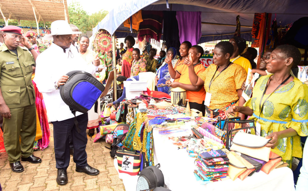 President Museveni pays a visit to some ladies at a previous Women's Day (PHOTO/File).