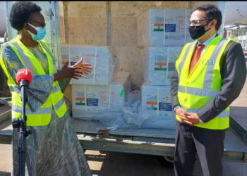 Health Minister Jane Ruth Aceng (left) and Indian High Commissioner to Uganda Ajay Kumar receive the 100,000 doses of the vaccine at Entebbe International Airport on Sunday (PHOTO/Courtesy).