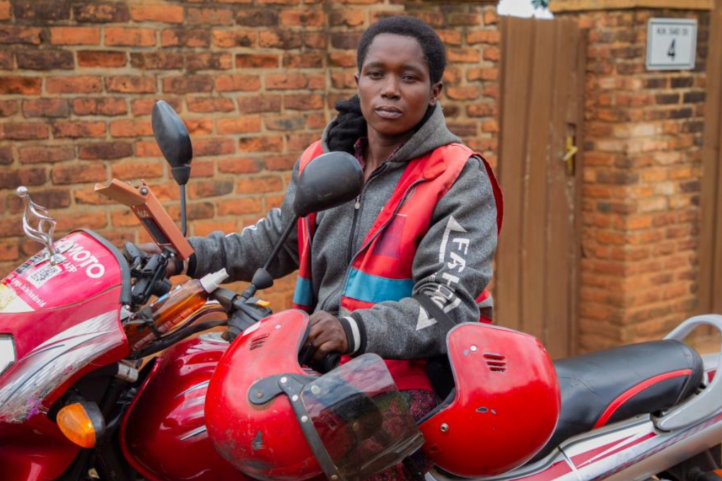 Female moto-taxi rider Claudine Nyirangirente poses for a photo in Kigali, Rwanda, March 23, 2021 (PHOTO/Xinhua).