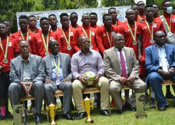 Fufa Executive Members (seated front row) pose for a group with The Hippos at Golf View - Entebbe (PHOTO/Courtesy)