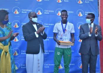 The Katikkiro of Buganda, Charles Peter Mayiga (R), Centenary Bank Managing Director, Fabian Kasi (2nd L), Centenary Bank Chief Manager Branding and Marketing, Ngulumi Immaculate (L), and the tournament Most Valuable Player from Busiro team, Arafat Usama, sharing a light moment. This was during the 2020 Masaza Cup St. Mary's Kitende stadium, where Gomba claimed the title by defeating Buddu 3-1 (PHOTO/Courtesy).
