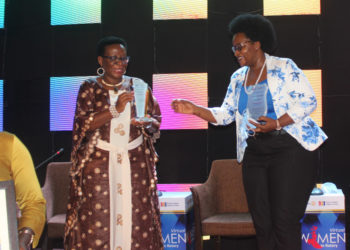 Mercy Kainobwisho, Registrar General URSB receives awards from Rosetti Nabumba of Rotary International during the award ceremony in Kampala (PHOTO/Courtesy).