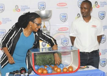 Sonia Karamagi randomly picks a choice at Mengo on Tuesday. (PHOTO/FUfa Media)
