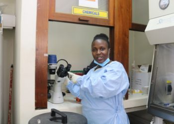 Dr Rose Nabatanzi, manager of Makerere University's Immunology research laboratory explaining some of the work that is done in the lab (PHOTO/Courtesy).