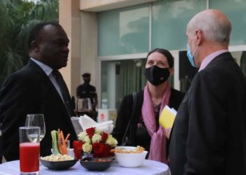 CJ Owiny-Dollo, the outgoing Chairperson of the Development Partners Group (DPG), Dr Roswitha Kremser and European Union Ambassador to Uganda, Attilio Pacifici respectively jazzing (PHOTO/Courtesy).