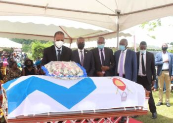 Justice Richard Buteera paying last respect to Justice Cosmas Matongo Kato, in Hoima on Tuesday (PHOTO/Courtesy).