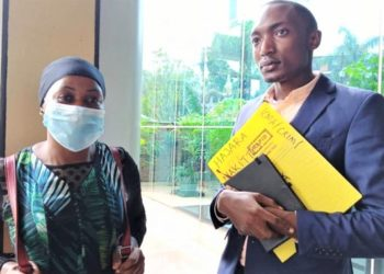Hajara Nakitto and her lawyer Abubakar Matanda at the High Court - Kampala. (PHOTO/Courtesy)