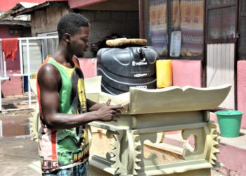 - A young carpenter polishes a coffin in the shape of a microphone at a coffin workshop in Accra, capital of Ghana, on March 23, 2021. Coffins in Ghana could not only be boxes that contain the deceased but also be artworks that vary in multiple styles, a unique way for people to commemorate their beloved ones. (Xinhua/Xu Zheng)