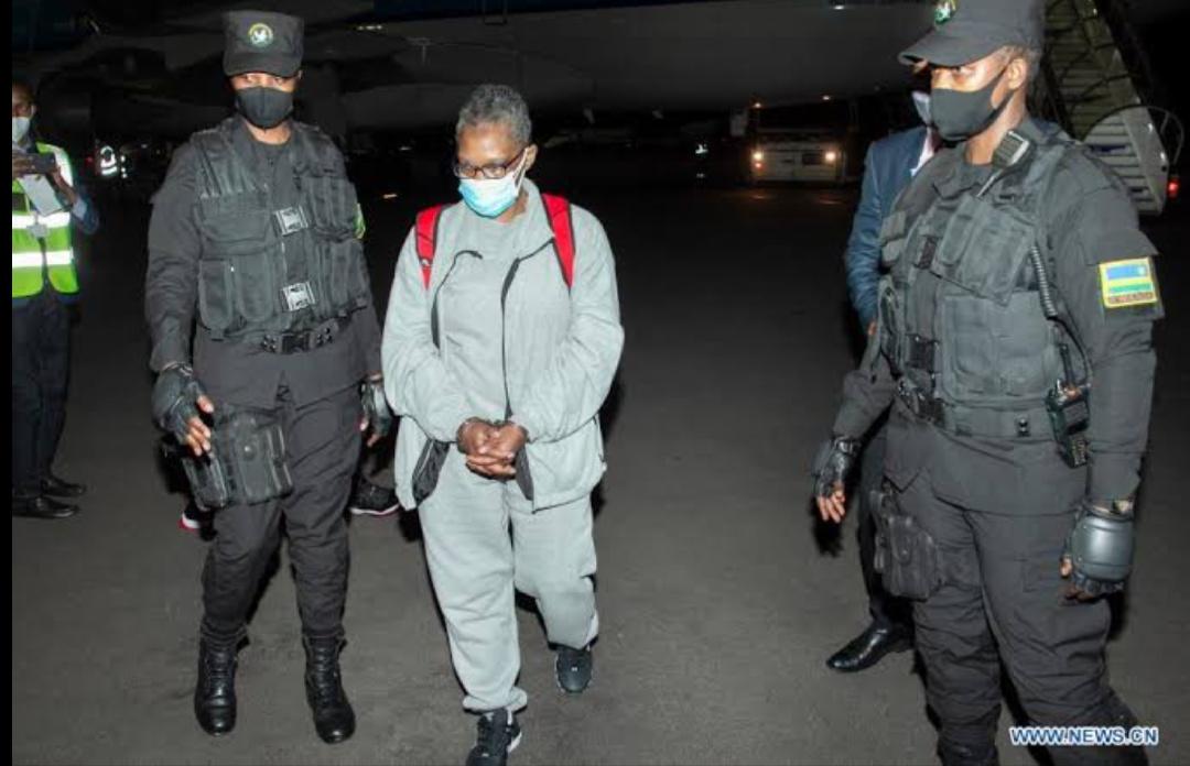 Beatrice Munyenyezi, a genocide suspect being escorted (PHOTO/Courtesy).