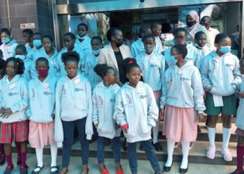 UCC Executive Director Irene Kaggwa with students from various schools (PHOTO/Courtesy).