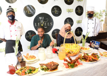 Ms Blessing Ahereza, the General Manager Levels Restaurant addressing the media. Looking on is Ms Ms Erinah Tusingwire the Human Resource Manager of Level's Kitchen (PHOTO/PML Daily).