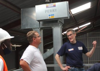 Perry Engineering Managing Director talking to one of the lead engineers, Pavel Tunik during a site visit to Rwenzori Agro-Processing Millers Ltd in Kasese (PHOTO/Courtesy).