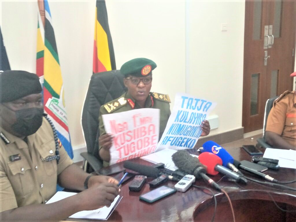 UPDF Spokesperson Brig. Gen, Flavia Byekwaso displays some of the posters of hate speech, she claimed, were confiscated from groups planning to cause chaos during President Yoweri Museveni's swearing in, ceremony scheduled for May 12. (PHOTO/Courtesy)