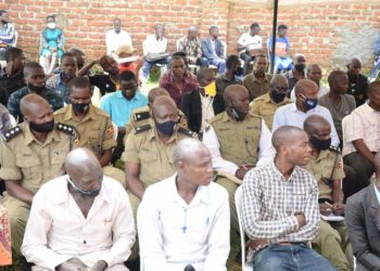 Some of Police officers and local leaders during the meeting in Bududa (PHOTO/Courtesy).