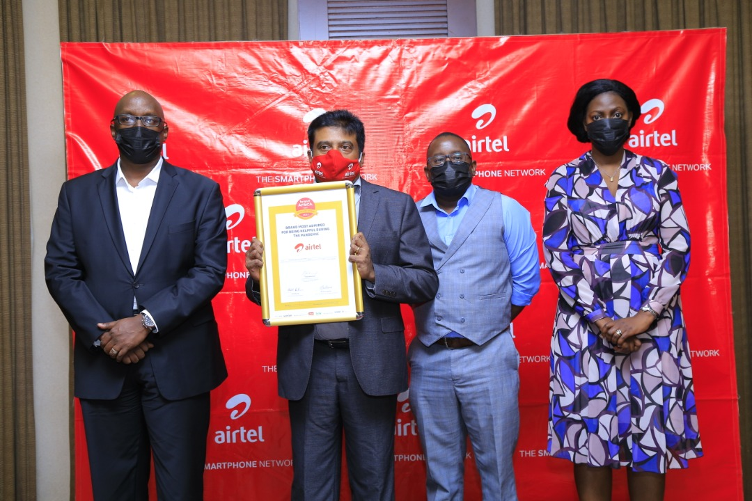 Manoj Murali (2nd L), Airtel Uganda - Managing Director, holding an accolade won by Airtel Uganda for Brand most admired for being helpful during the pandemic as recognised by the 2021 Brand Africa 100 Awards, Dennis Kakonge (L), Legal and Regulatory Director at Airtel Uganda, Allan Ssemakula (2nd R), Director Airtel Business and Sumin Namganda (R) PR Manager at Airtel Uganda. This was during the Airtel Uganda 2020 and Future Performance Media Round Table held at Kampala Serena Hotel (PHOTO /Courtesy).