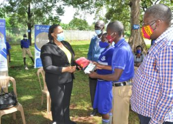 Eskom MD Thozama Gangi hands over items to be used to maintain COVID-19 standard operating procedures to pupils of Njeru primary school. Looking on is the headteacher and chairman board of directors (PHOTO/Courtesy).
