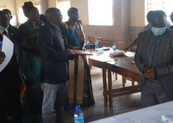 Rev. Fr. James Ssembatya prepares to handover to New Board Chairman Rev. Fr. Tamale (PHOTO/Courtesy).