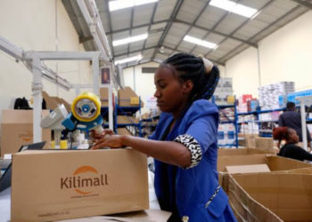 An employee packages goods at a warehouse of the e-commerce platform Kilimall in Nairobi, capital of Kenya, Nov. 1, 2019. (PHOTO/Xinhua).