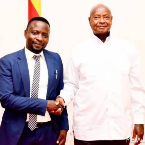 Mr. Hillary Musoke Kisanja and President Yoweri Museveni (PHOTO /Courtesy)