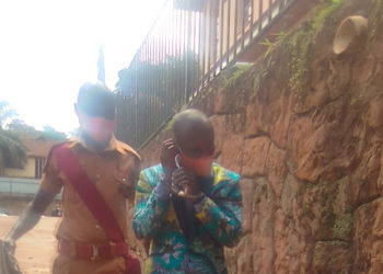 Suspect Mpagi Didas being escorted (PHOTO/Courtesy).