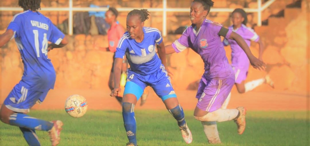 Record Champions - Kawempe Muslim (Blue) play Kampala Queens, earlier in the competition. Lady Doves ejected them 1-0 on Monday. (PHOTO/Courtesy)
