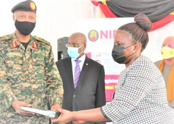Ms Rosemary Kisembo receives office files from Brig. Gen Stephen Kwiringira. (PHOTO/Courtesy)