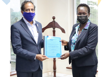 Lycamobile Uganda CEO Vinay Choudary receiving the NTO from UCC Ag. Executive Director Irene Kaggwa Sewankambo (PHOTO /Courtesy)