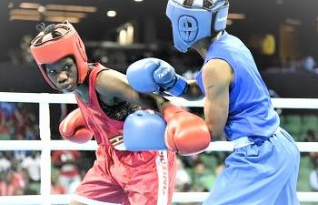Female boxer - Catherine Nanziri (Red) ready to punch at the Tokyo Olympics. (PHOTO/Courtesy)
