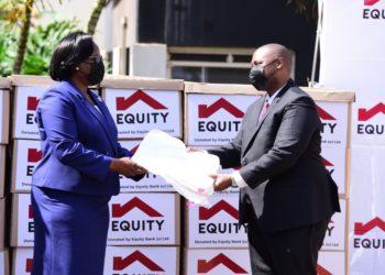 Equity Bank Uganda Executive Director Mr. Anthony Kituuka and Kampala Capital City Authority Executive Director Dorothy Kisaka (PHOTO /Courtesy)