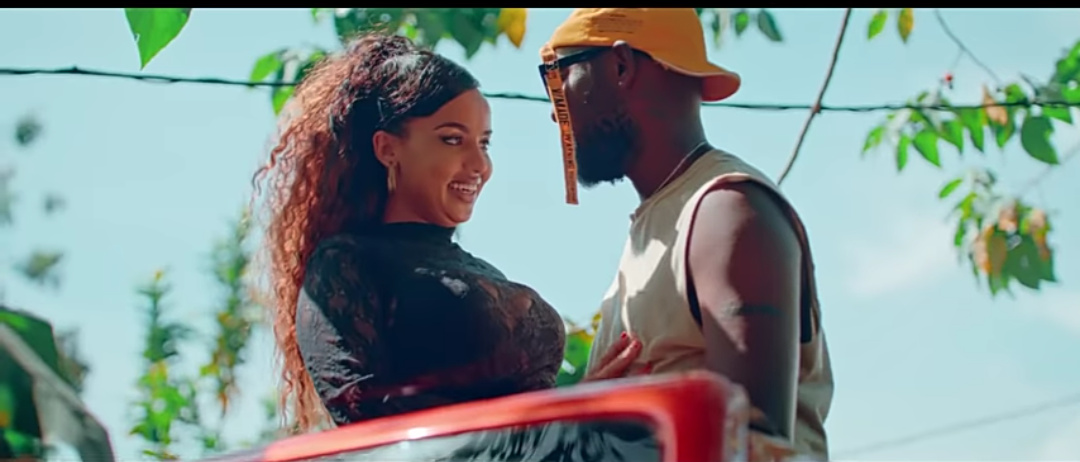 Singer Eddy Kenzo and a video vixen in the newly released weekend video (PHOTO/Video grab).