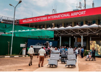 Passengers arriving on international flights leave the international arrivals lobby after they have been screened and cleared for any symptoms of the novel coronavirus at Entebbe Airport, Uganda (PHOTO /Courtesy)