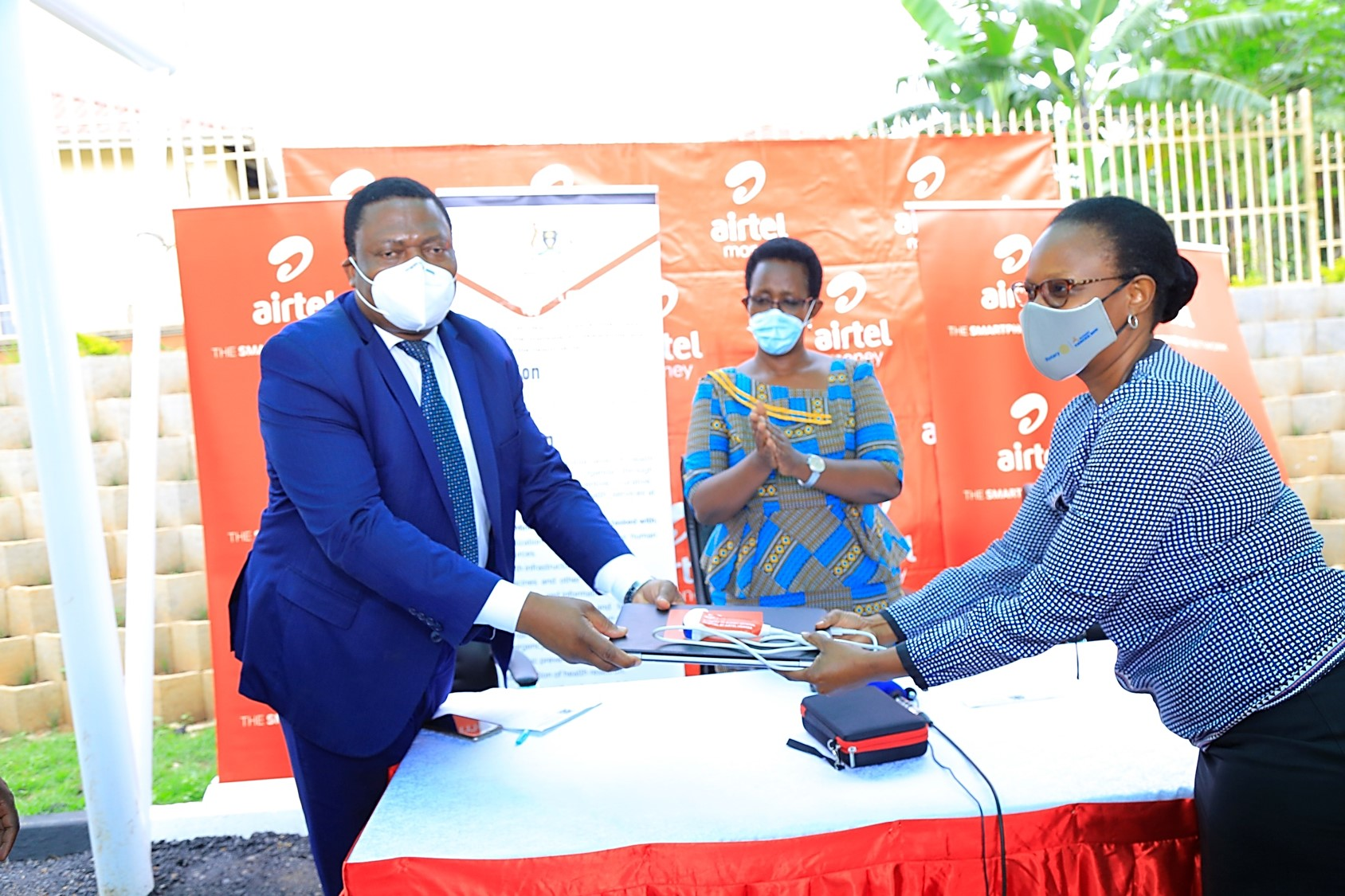 Airtel Uganda HR Director Flavia Ntambi hands over the Ultrasound device donated to Bukwo district officials.  Center is Ministry of Health PS Dr. Diana Atwine (PHOTO /Courtesy)