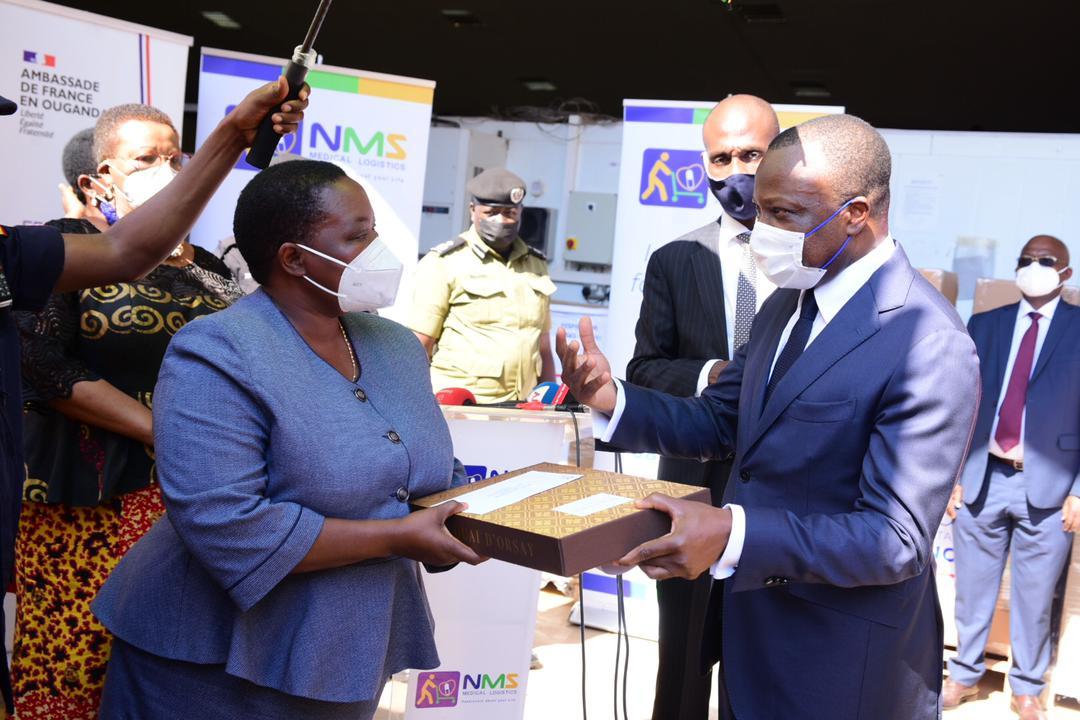 Prime Minister Robinah Nabbanja (R) receiving the donation from Jules-Armand Aniambossou, the Ambassador of France to Uganda on Tuesday (PHOTO/Courtesy).