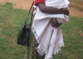 Racheal Namono, 14, with her six months old baby in Bumoni sub-county, Namidindwa district (PHOTO/David Mafabi).